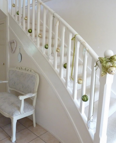 Don't like Greens? Say goodbye to them and simply hang a bunch of ornaments on your staircase's railing.