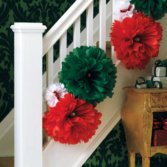 Here is a super simple and quick way to dress up the staricase. Simply hang a bunch of oversized flowers on banisters. Just make sure they are in different sizes and have seasonal colors.