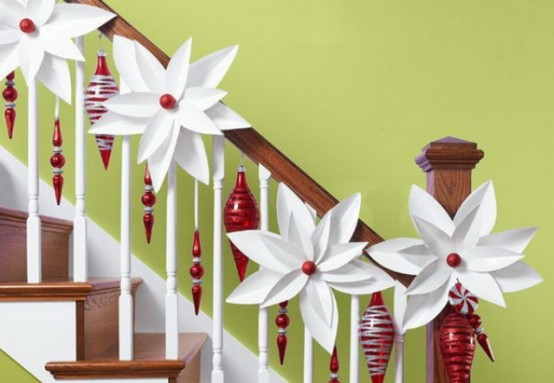 The mix of white snowflakes and red ornaments look very chic and cool on the white guardrails.