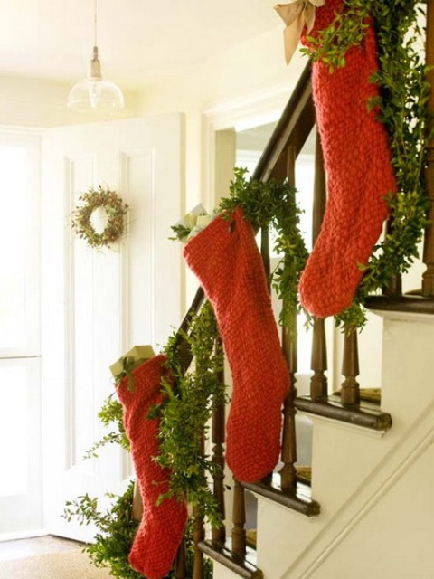 Add to the traditional staircase evergreen swag some Christmas stockings in seasonal colors.