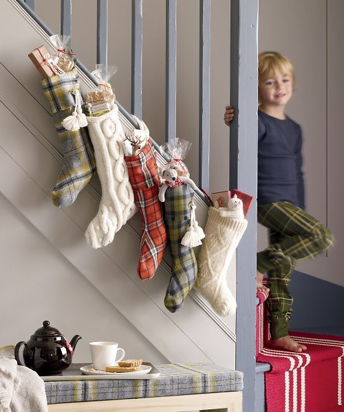 Do you have a bunch of old plaid tablecloths? Use them to make some Christmas stockings for a mantel or for a staircase.