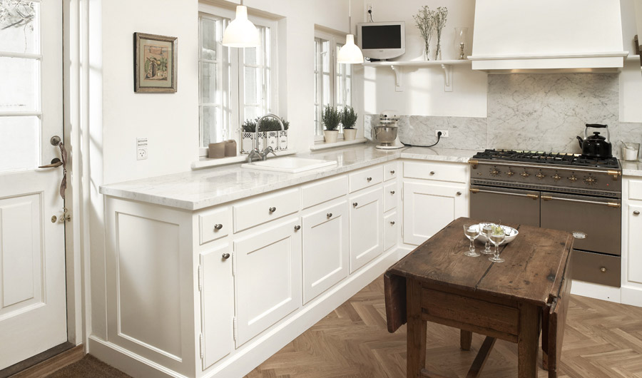 Classic Framed White Kitchen With Marble