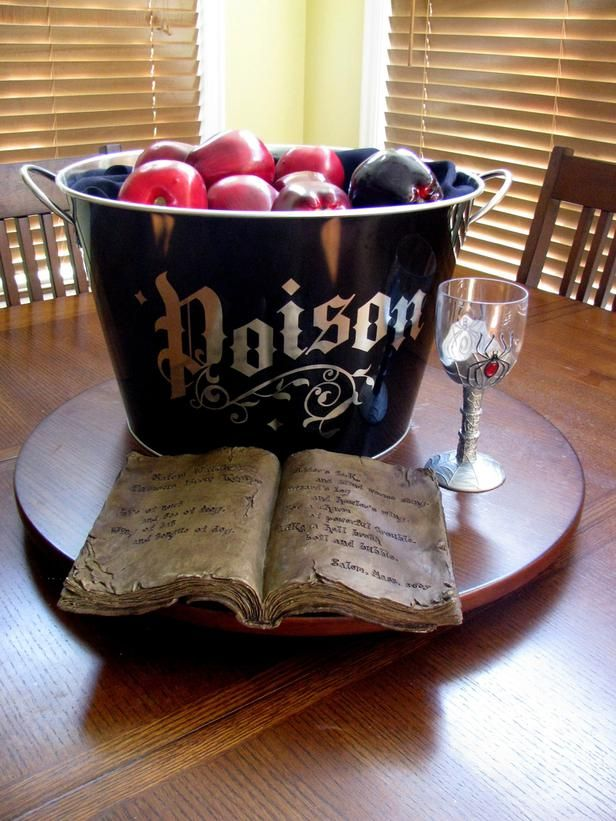 a cauldron with poisoned apples done in black and red is a pretty centerpiece or way to style your fruits