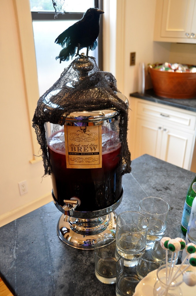 a tank with burgundy lemonade, blackcheesecloth and a crow on top for perfect Halloween styling