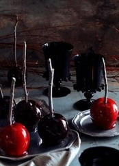 black, red and deep purple candied apples on sticks are lovely Halloween desserts to rock