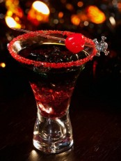 an ombre black to red cocktail with a red sugar rim and a red cherry on top is delicious for a Halloween party