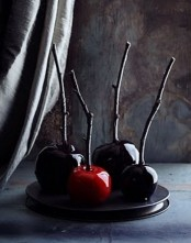 minimalist Halloween treats – black and red candied apples on sticks are amazing for making your guests and family happy