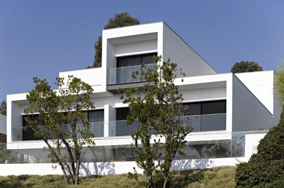 White Concrete Three-Storey House – CS House by Pitagoras Arquitectos