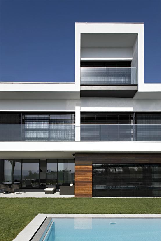 White Concrete Three Storey House Cs House By Pitagoras