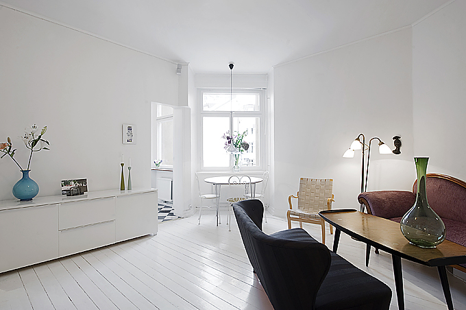 Clean white small apartment interior design with Micro apartment interior design