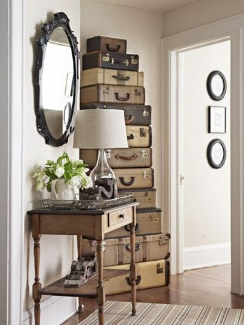 Reusing vintage suitcases is a cool idea to make a decorative storage solution.