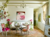 a vintage spring living room with green tables and lamps, pink lamps and chairs, bold artworks, greenery blooms