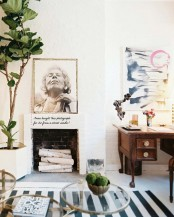 fresh spring touches with greenery, moss, bright artworks is a cool idea for a living room