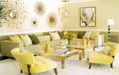 a bright spring living room with a neutral sofa, yellow chairs, green and yellow pillows and sunburst mirrors and artworks