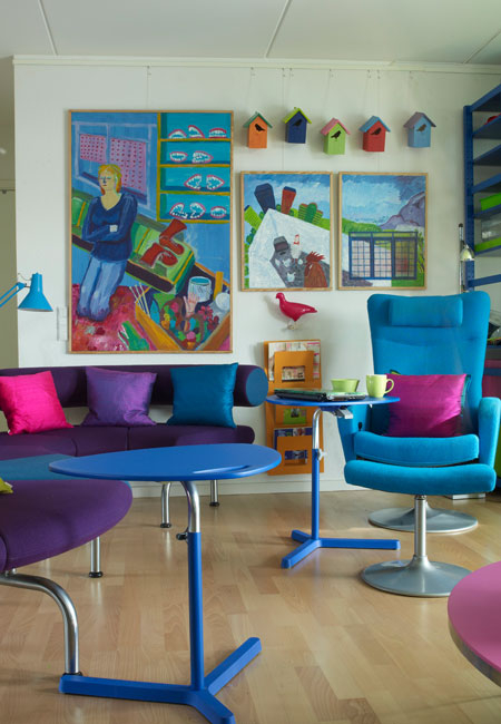Colorful apartment design with interior in organized chaos for Colorful living room furniture