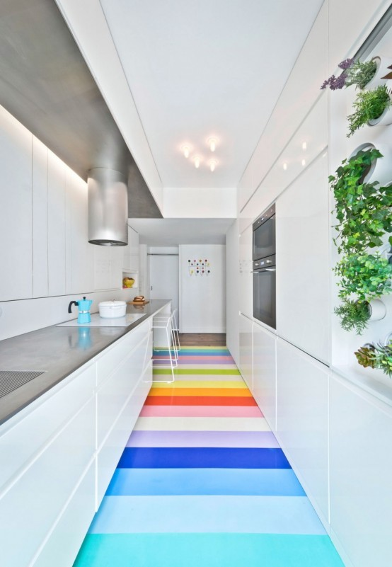 Colorful Apartment With A Multi Functional Wall Unit