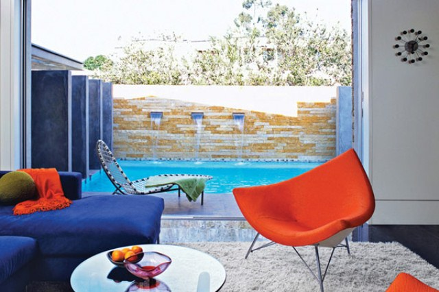 Colorful Atomic Ranch With A Glass Corner