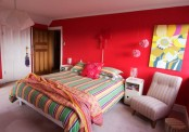 Colorful Bedroom With A Bright Pink Wall