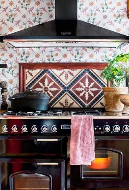 a colorful tile backsplash and an additional backsplash over the cooker