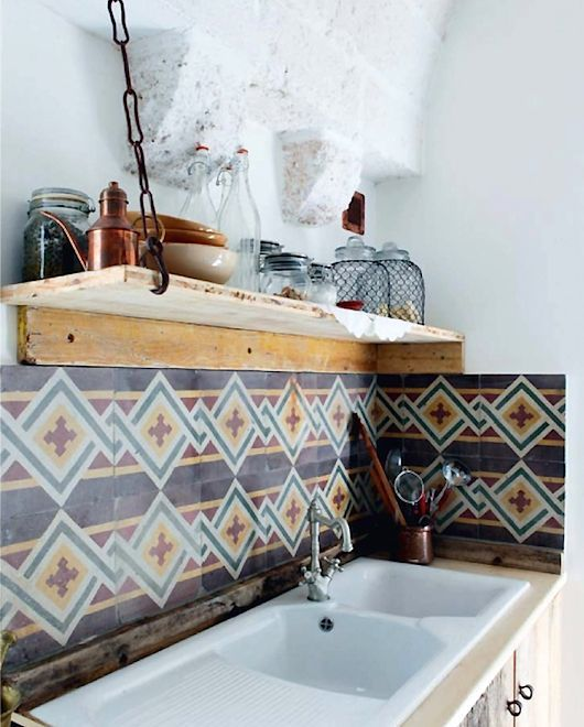 a bright tile backsplash is a cool idea to spruce up the space