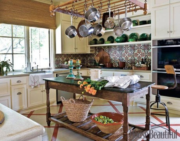 a bright tile backsplash and yellow cabinets plus some vintage furniture
