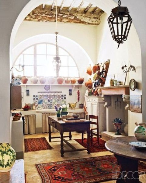 colorful rugs, tiles and porcelain make this neutral boho kitchen bright