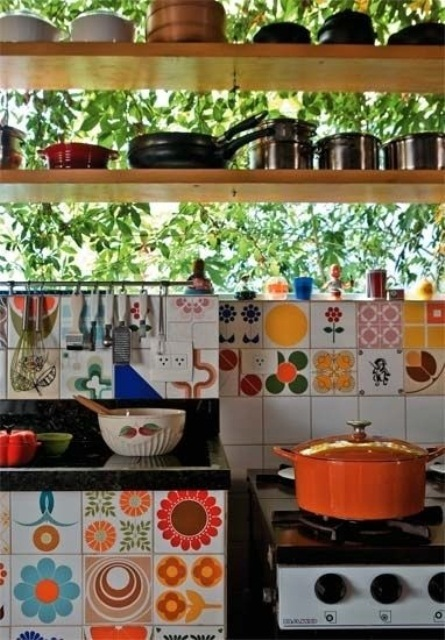 colorful mismatching tiles make the backsplash bold and the cabinet, too