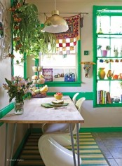touches of bright green, colorful porcelain and lots of potted greenery and blooms