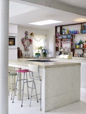 super bright porcelain, a colorful mirror and mismatching colorful stools for adding a boho chic feel