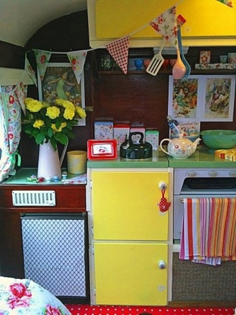 a burgundy and sunny yellow kitchen plus green countertops and fabric buntings