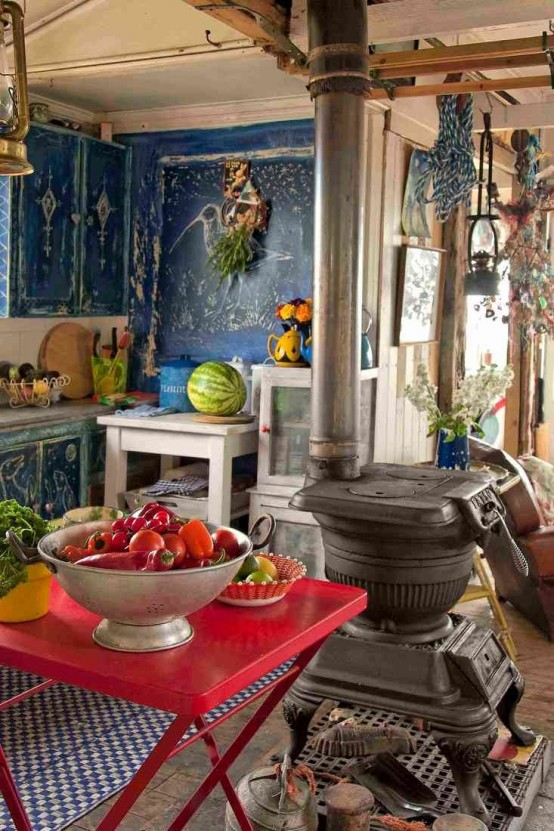 painted blue walls, bright textiles and a hot red table