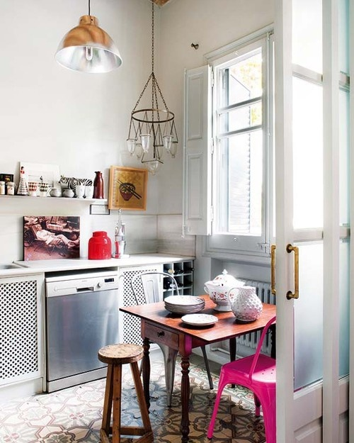 a neon pink chair and a red jar spruce up this boho meets industrial kitchen