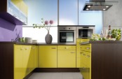 a bold kitchen with lemon yellow and brown cabinets, a purple backsplash and stainless steel appliances is modern and bold