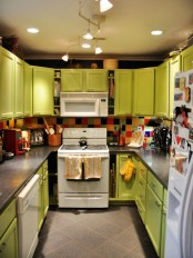 a bold lime green kitchen with a colorful tile backsplash and vintage appliances is a super bold and cool space