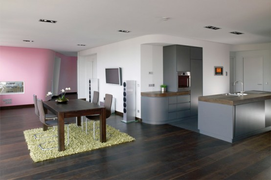 Colorful Loft Design With Wall Integrated Service Spaces