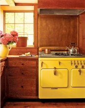 a vintage kitchen done in rich stain, with bold yellow touches is a lovely and chic space