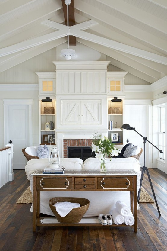 Comfy farmhouse living room designs to steal built in cabinetry on both sides of the fireplace provide a sense of balance