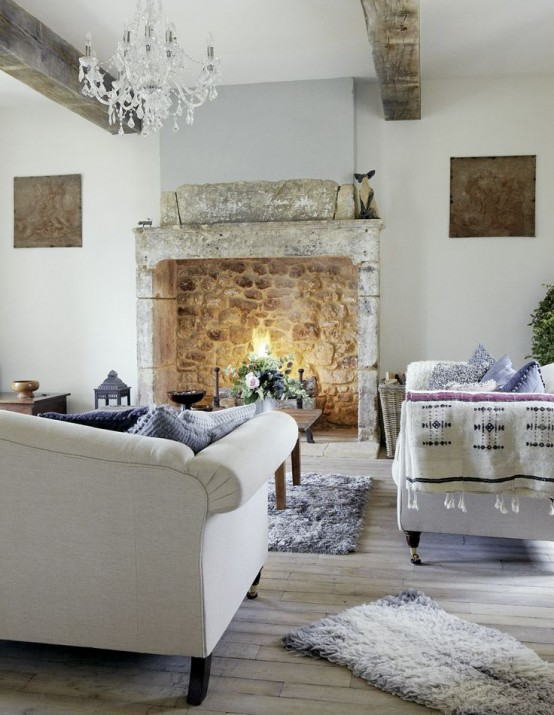 Old wood beams can draw the eye to the ceiling even in such gorgeous, airy and cozy space.