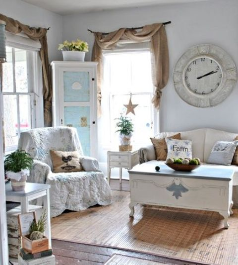 Shabby Chic Furniture Surrounds A Vintage Coffee Table That Looks Like A  Chest. An Antique
