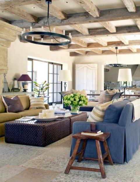 Farmhouse interiors often feature exposed wooden beams like this living room. The cool thing about them that they make any space captivating, cozy and special.