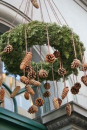 a fir chandelier with pinecones hanging is a great rustic decoration for both indoors and outdoors, make it yourself