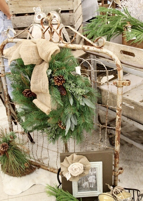 a shabby chic wire net with a fir wreath with pinecones and a burlap bow is a pretty vintage decoration for indoors and outdoors