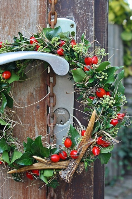 a greenery wreath with antlers, berries, twigs is a bright and chic natural touch to your outdoors and will bring some color