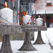 vintage candleholders with berries and candles can light up your front porch or some other space
