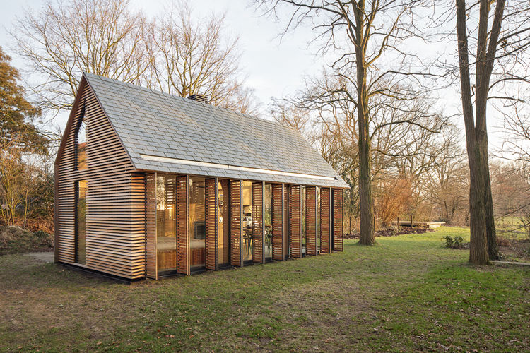 Completely Hand-Built Wooden Cabin Filled With Light