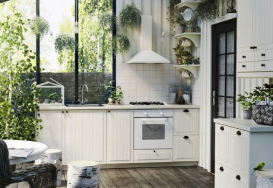 Completely White Kitchen With Lots Of Greenery