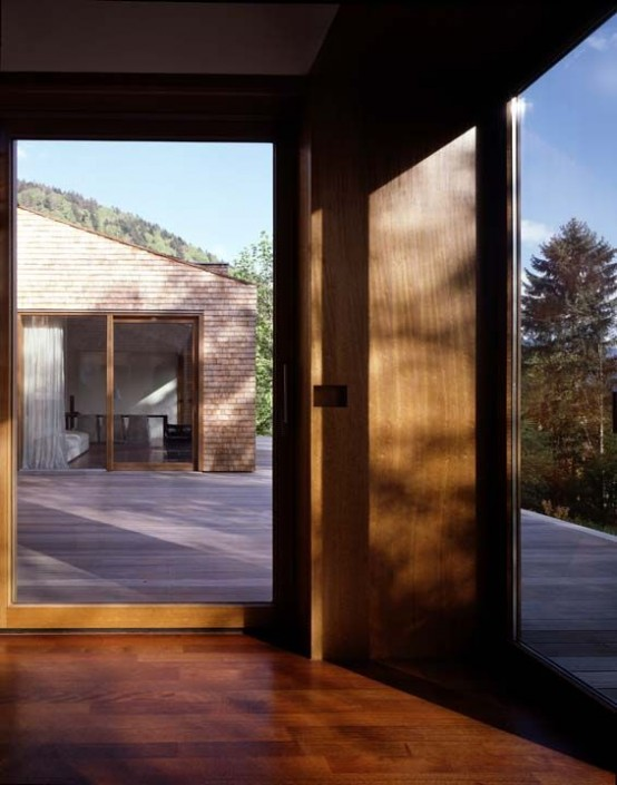 concrete house partly covered with larch shingles