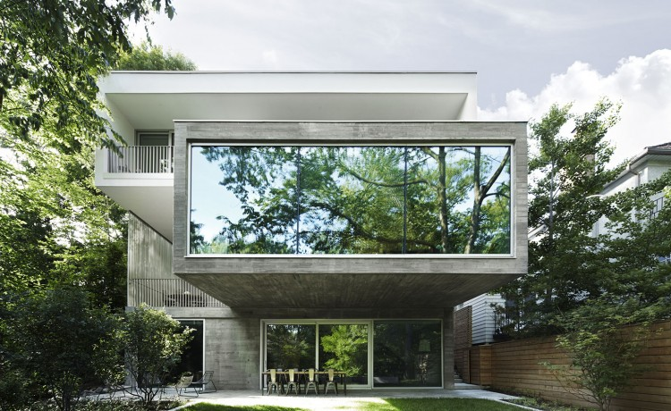 concrete modern house made of several stacked volumes