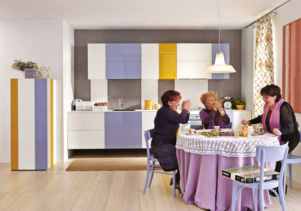 a minimalist yet colorful kitchen with white, mustard and lavender colors, a vintage dining table with a lace cover looks very unusual