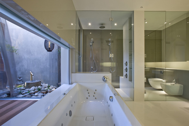 Contemporary house with completely stainless steel kitchen for Bathroom designs melbourne